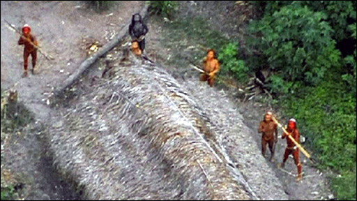 An overflying plane discovered this tribe deep in the Amazon jungle that is as yet, untouched from the outside. The people below are responding to the unusual sight of the plane above them.
