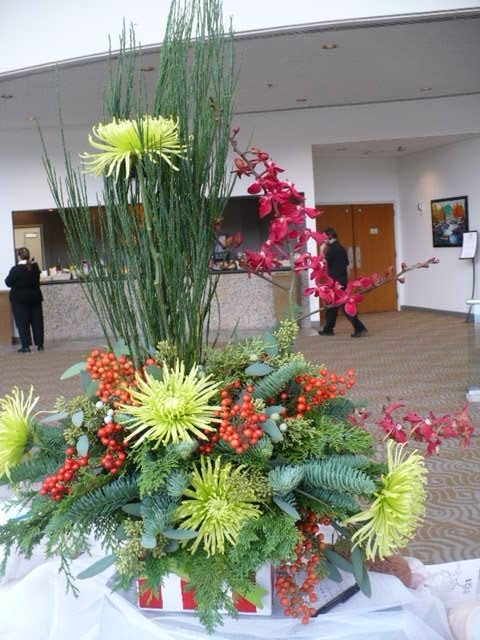 If you want a lasting centerpiece, choose flowers that will last. Orchids and mums can last for at least 2 weeks, if not more.