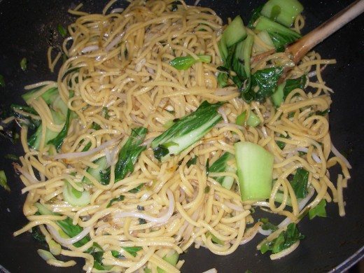 Add noodles, cook for 3 minutes. Add the Oyster, Soy & Chilli Sauce to the wok and fry for 3 minutes or until the noodles have heated up. Add the chicken & prawns to the noodles.