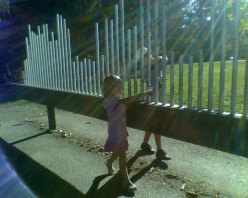 """Playing the """"Musical Fence"""" at DeCordova Art Museum's Sculpture Park"""