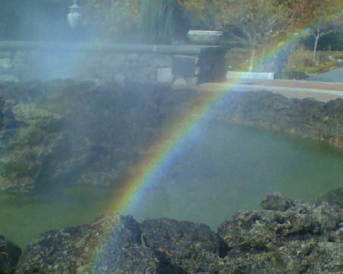"Rainbow captured in the ""Primordial Pool"" fountain at Tower Hill Botanical Garden"