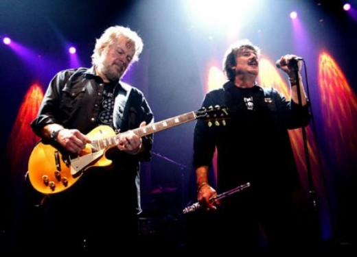 Randy Bachman (left) performing with Burton Cummings.