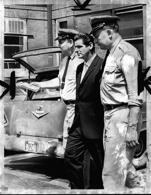 Albert Desalvo who claimed to be the Boston Strangler is being escorted by two polic in this photo.