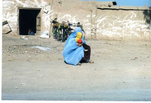 woman with baby at refugee camp outside Peshawar