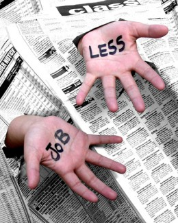 """open hands with employment section of newspaper with words written on the palms """"j less"""""""