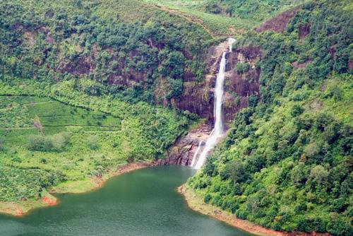 Adams Peak falls at the edge of Mausakelle resevior - Maskeliya