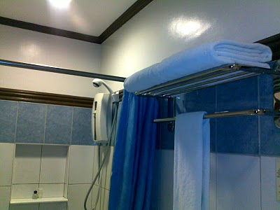 Clean bathroom with hot & cold showers