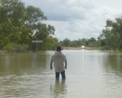 Alwin wading into the flood