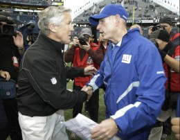 Seattle Seahawks head coach Pete Carroll, left, and New York Giants head coach Tom Coughlin, right, shake hands following an NFL football game, Sunday, Nov. 7, 2010, in Seattle. The Giants beat the Seahawks, 41-7. (AP Photo/Ted S. Warren)