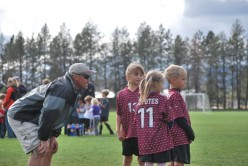 Coach pep talk before soccer game