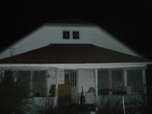 The front of my house at night.