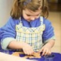 A young girl helps with the Christmas baking!