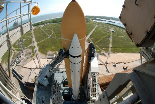 View of the External Tank, Solid Rocket Boosters, and Space Shuttle Discovery from the FSS. The RSS has not been rotated into position around the shuttle yet.