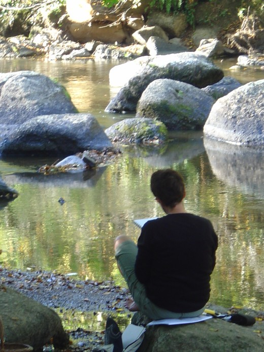 Student sketching by the River Glane, Saint Junien