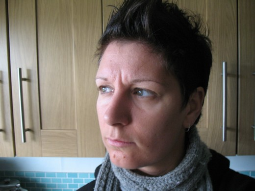 This is the hairstyle I was sporting until recently.  I accidentally chopped it off though, when I got bored and couldn't afford to go to the hairdresser.  Not to worry.  It will grow back to this length within about eight weeks.