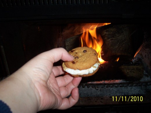 Gently place the hot marshmallow over the M&M's, using the other cookie, squish together.  Caution! Hot Marshmallow!
