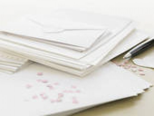 Be savvy when addressing your wedding invitations' envelopes to avoid problems with extra guests.