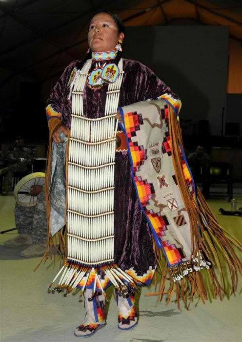 Sgt. Mary Ann Bullhead-Chavez, a military police officer with the 720th Convoy Support Battalion out of Albuquerque, N.M., performs a women's northern traditional dance which originated from the Native American Plains tribe at the National Native Ame