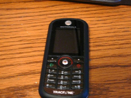 Tracfone Motorola C261 Camera Phone.  This is a very inexpensive candy bar style phone that works well.