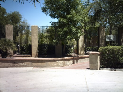 View fence around sculpture garden in Tucson's Garden of Gethsemane Felix Lucero Park.