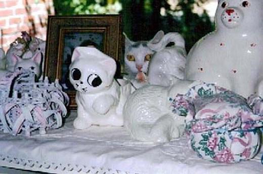 Little One among porcelain figures