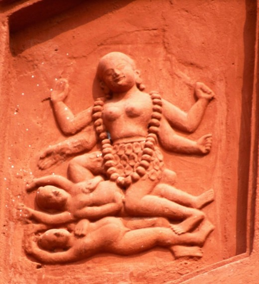 Goddess Kali with two Shivas beneath Her, the lower one is Sadashiva (representing the Nirguna Bramha) & the upper one is Mahakala Shiva (representing the Saguna Bramha).