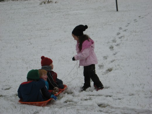 Outdoor activites for kids like sledding and snowplay provide fresh air and exercise.