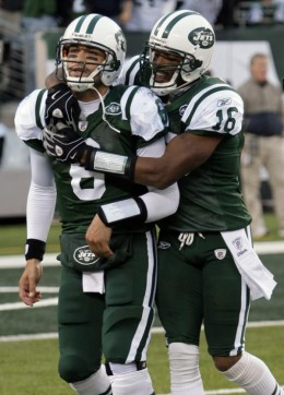 New York Jets Brad Smith (16) celebrates with quarterback Mark Sanchez (6) after Sanchez threw a touchdown-pass to win an NFL football game during the fourth quarter against the Houston Texans at New Meadowlands Stadium, Sunday, Nov. 21, 2010, in Eas