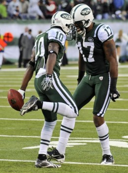 New York Jets wide receiver Santonio Holmes (10) celebrates with teammate Braylon Edwards (17) after catching a touchdown-pass during the fourth quarter of an NFL football game against the Houston Texans at New Meadowlands Stadium, Sunday, Nov. 21, 2
