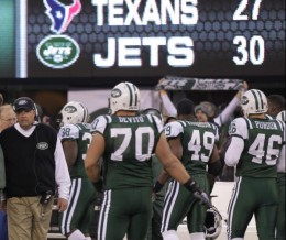 New York Jets head coach Rex Ryan, left, looks on from the sidelines during the fourth quarter of an NFL football game against the Houston Texans at New Meadowlands Stadium, Sunday, Nov. 21, 2010, in East Rutherford, N.J. The Jets won the game 30-27.