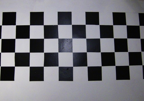 Black and white checkerboard wall covering.