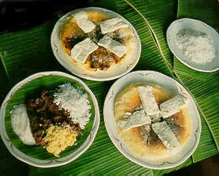 Bibingka (baked rice cake on pan ) with white chesse toppings made out of carabao's milk