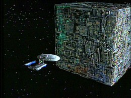 A Borg cube in Star Trek. An advanced biological technological hybrid, cable of self replication, on a continuing mission to spread their influence and assimilate others across the universe. Surprisingly they seemed remarkably slow at this...