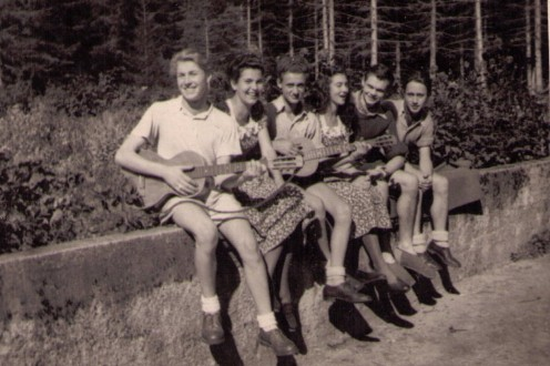 Opa, third from the left, playing guitar at the base of the Black Forest in Germany in 1949