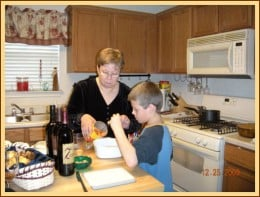 My step-great-grandson, Logan, helping his maternal grandmother, Penny, with the preparations. last time (now he's 10)