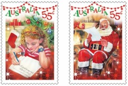 Australia's Postage Stamps for Christmas 2010 illustrating a child writng a letter, and Santa reading one.
