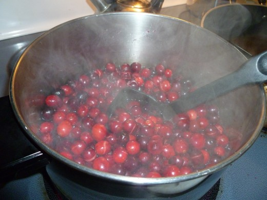 Whole cranberries being made into sauce - a nutritional powerhouse.
