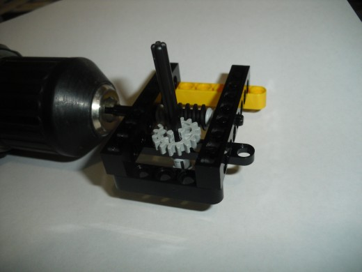 A simply machine built with Lego Technics and powered by a DeWalt drill.
