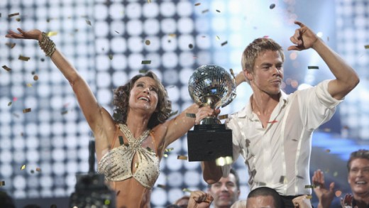 The winner of the 2010 episode of the abc. Dancing with stars is Jennifer Grey and her partner Derek. with the trophy.