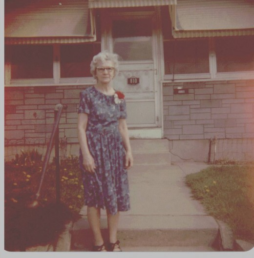 My wifes mother in front of the house they lived in when I met her.