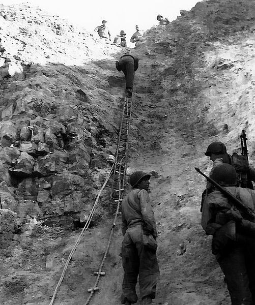 After the fact, they are showing the ladders used to storm the cliffs on D-Day.  Public Domain