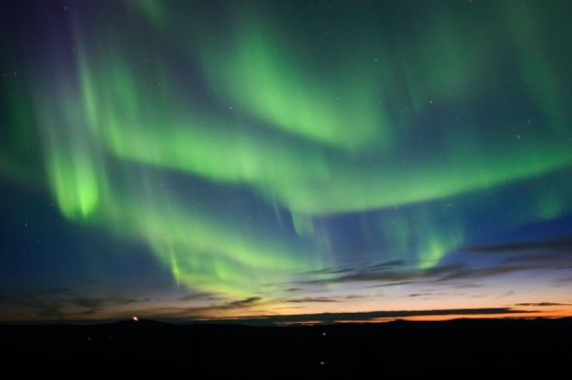 The aurora borealis is a good way to observe the earth's shifting magnetic field. In this photo, we can see the discreet character of the geomagnetosphere and its ongoing change that comes from inside and outside of the earth.