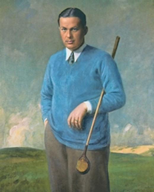 Portrait of Bobby Jones in blue sweater with a golf club