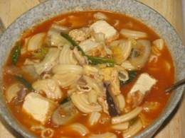 Pasta soup: pasta with tofu, mushrooms, squid, spinach, eggs, carrots, Chinese leaks