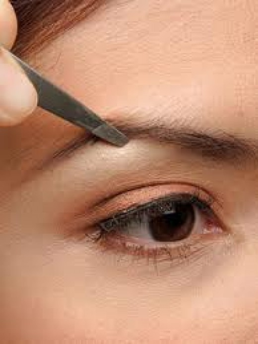 Tweezing is an inexpensive and fast way to keep your eyebrows in shape, if you're good at creating symmetrical lines.