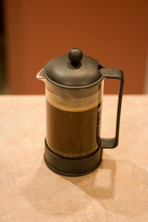 A French press brewing coffee.