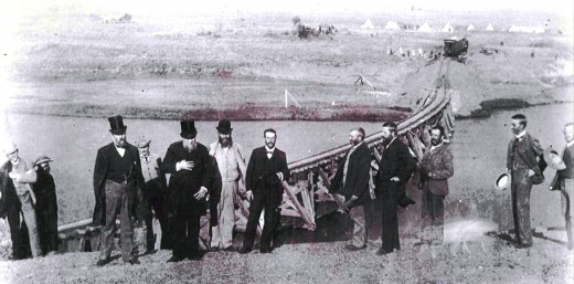 President Reitz of the Free State and President Kruger of the ZAR on the occasion of the joining of the Transvaal and Free State by railway, 21 May 1892. Sammy Marks stands fifth from the right. Image Wikipedia
