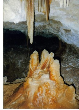Stalactites and stalagmites with colorful minerals.