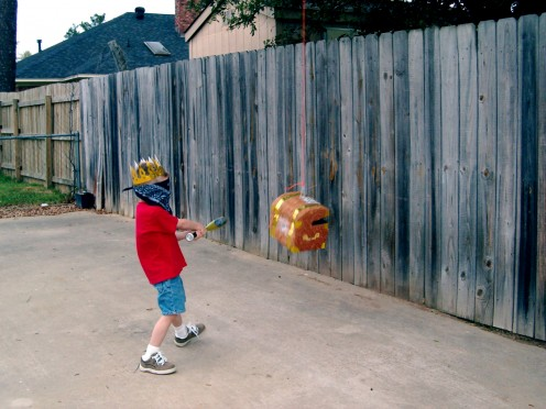 My little boy, blindfolded and hitting the pinata with a bat on his birthday.