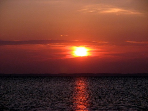 The sun setting over the beautiful Chesapeake Bay just off of Saxis Island, Virginia, U.S.A. Photo by Windy Grace Mason.